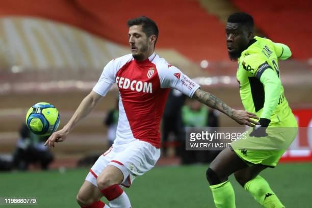 Monaco's Yugoslavian forward Stevan Jovetic vies with Angers' Ivorian defender Ismael Traore during the French L1 football match Monaco vs Angers on...
