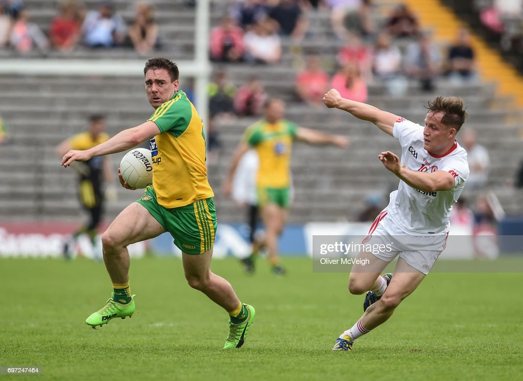 Monaghan , Ireland - 18 June 2017; Martin Reilly of Donegal in action against Kieran McGeary of Tyrone during the Ulster GAA Football Senior Championship Semi-Final match between Tyrone and Donegal at St Tiernach's Park in Clones, Co. Monaghan.