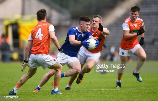 Monaghan Ireland 2 June 2019 Dara McVeety of Cavan in action against Mark Shields and Paul Hughes of Armagh during the Ulster GAA Football Senior...