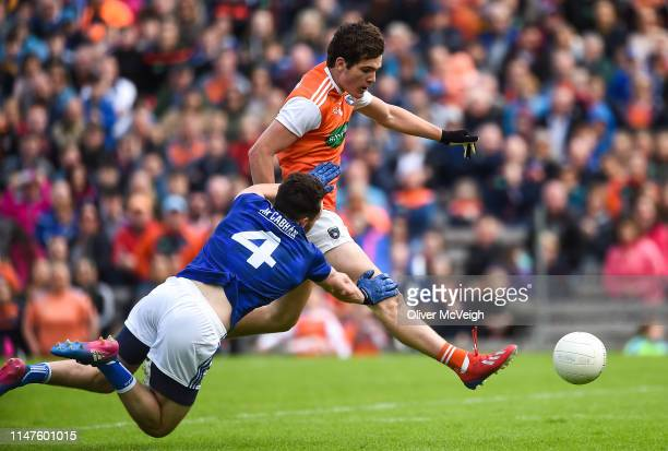Monaghan Ireland 2 June 2019 Jarleth Óg Burns of Armagh scoring his side's first goal despite the attention of Conor Moynagh of Cavan during the...
