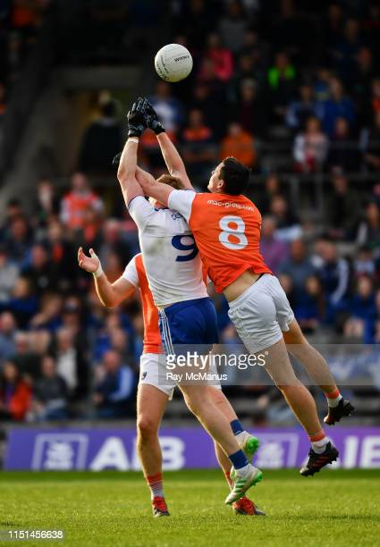 Monaghan Ireland 22 June 2019 Kieran Hughes of Monaghan jumps with Armagh players Aaron Forker and Brendan Donaghy in an effort to win possession...