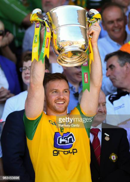 Monaghan Ireland 24 June 2018 Eamonn Doherty of Donegal lifts the trophy following the Ulster GAA Football Senior Championship Final match between...