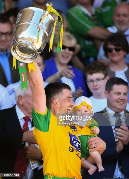 Monaghan Ireland 24 June 2018 Paddy McGrath of Donegal with his daughter Isla Rose lifts the trophy following the Ulster GAA Football Senior...