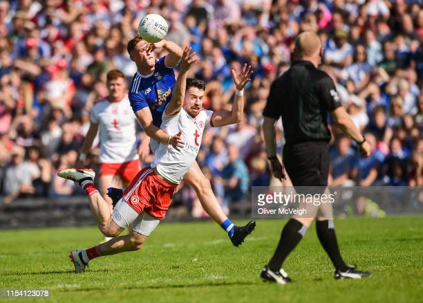 Monaghan Ireland 6 July 2019 Matthew Donnelly of Tyrone in action against Ciaran Brady of Cavan during the GAA Football AllIreland Senior...