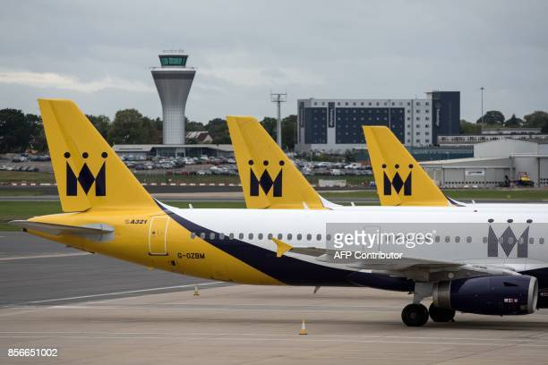 Monarch Airlines aircraft are pictured on the tarmac at Birmingham Airport in Birmingham central England on October 2 2017 British shorthaul carrier...
