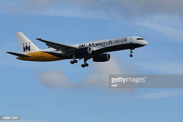monarch boing jet landing at gatwick airport - pejft stock pictures, royalty-free photos & images