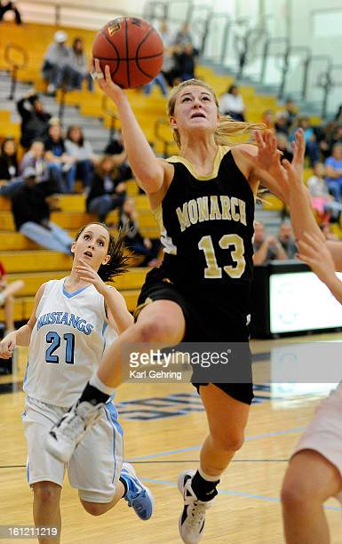 Monarch shooting guard Ashton Davis made a drive to the hoop Tuesday night The Monarch High School girl's basketball team used aggressive defense and...