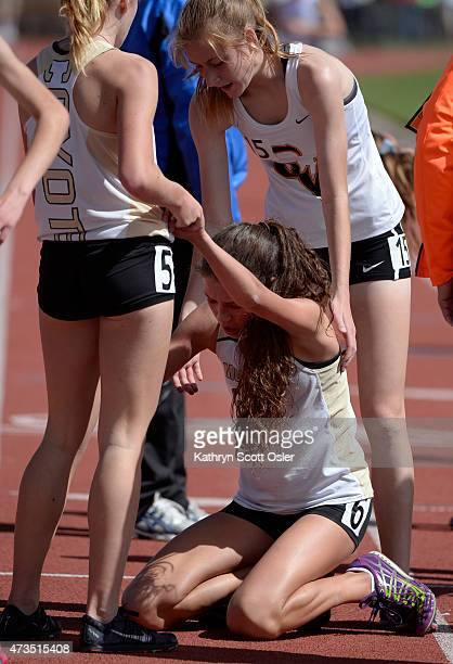 Monarch teammate Holly Bent left and Savanna Dalton right from Castle View help Audrey Lookner to her feet after the three finish the 5A girls 3200...
