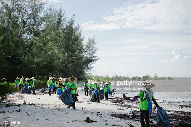 CONTENT] Monash University Sunway Campus students carry black plastic bags and use trash clippers to collect rubbish on the beach on May 11 2013 This...