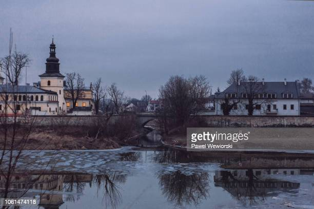 monastery and vistula river in winter, krakow, poland - cieszyn stock pictures, royalty-free photos & images