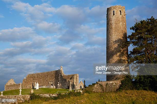 monastery of clonmacnoise - irish round tower stock photos and pictures