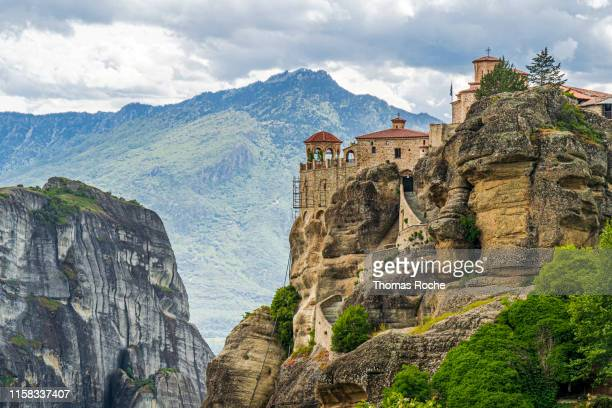 a monastery on the peak in the meteora rock formation - thessaly stock pictures, royalty-free photos & images