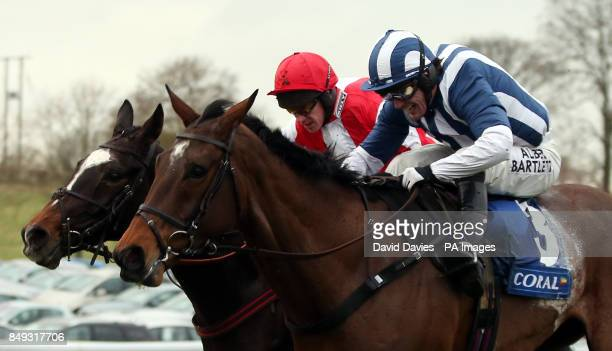 Monbeg Dude ridden by Paul Carberry gets up to beat Teaforthree ridden by Tony McCoy in the Coral Welsh National Handicap Chase during the Coral...
