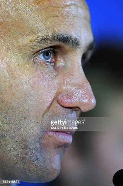 Monchengladbach's German head coach Andre Schubert speaks during a press conference at Celtic Park stadium in Glasgow on October 18 ahead of the...