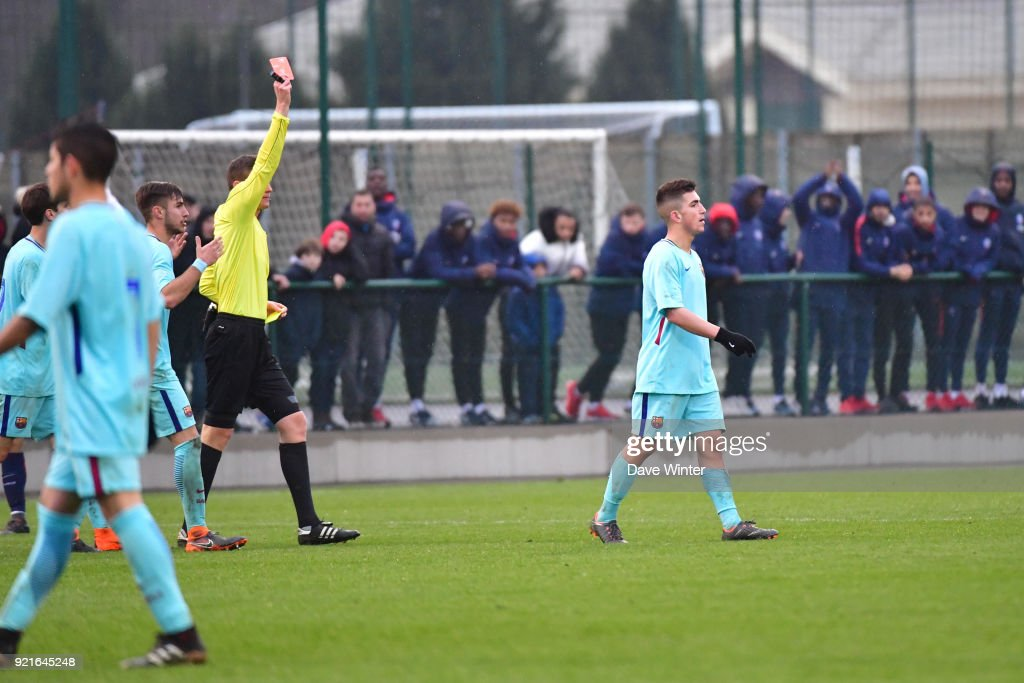 Monchu of Barcelona receives a red card from referee Daniel Siebert during the UEFA Youth League match (round of 16) between Paris Saint Germain (PSG) and FC Barcelona, on February 20, 2018 in Saint Germain en Laye, France.