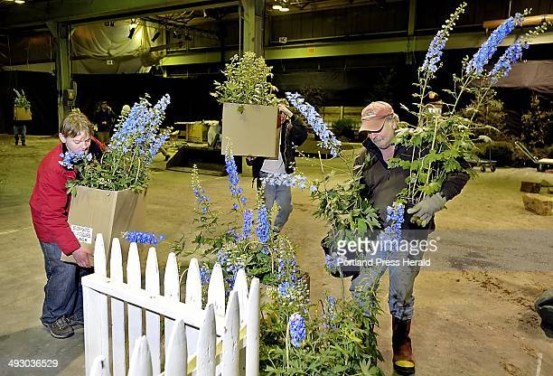 Monday March 5 2012 Irving Day left Michael Gelzinis center and Harvey Wilbur help carry flowers into the Flower Show at Portland Company on Fore...