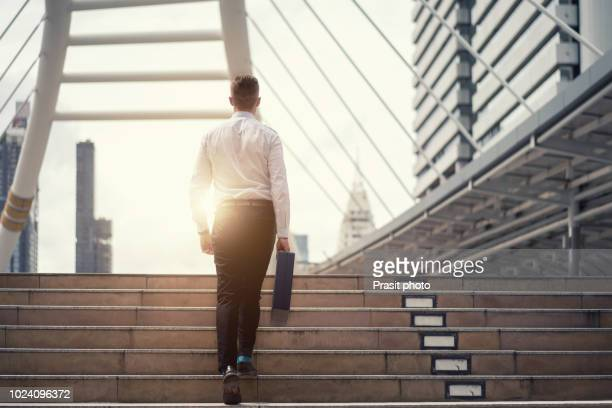 monday morning of work businessman walking up the stairs in a rush hour to work. hurry time. working man - moving up stock pictures, royalty-free photos & images