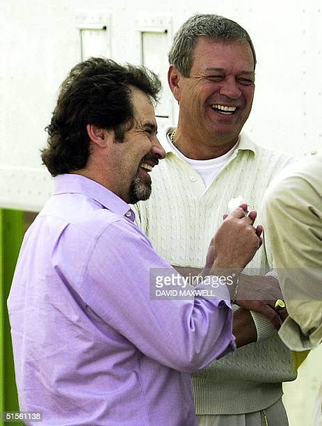 Monday Night Football broadcaster Dennis Miller talks with Monday Night Football producer Don Ohlmeyer before the broadcast of the Pro Football Hall...