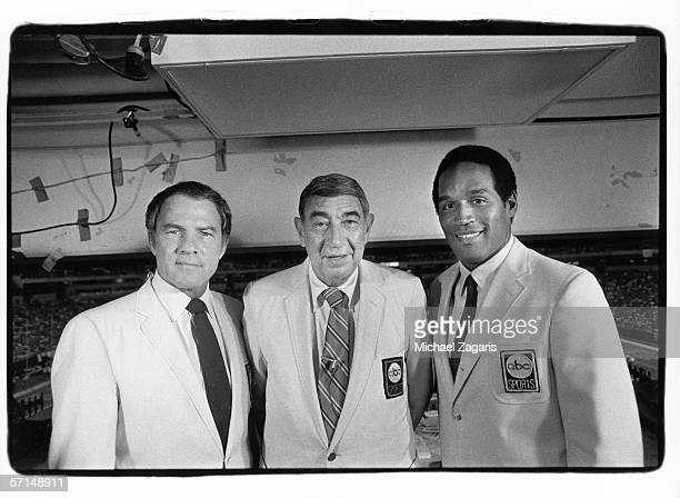 Monday Night Football broadcasters Frank Gifford Howard Cosell and OJ Simpson pose for a photo before the Minnesota Vikings game against the San...