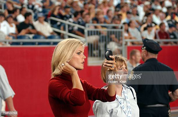 ABC Monday Night Football sideline commentator Melissa Stark checks her makeup during the game between the Pittsburgh Steelers and the New England...