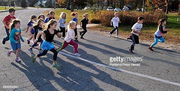 Monday October 21 Sebago Elementary School Fifth grade teacher Kimberly Kelly works with her running club that includes 40 out of the 83 students at...