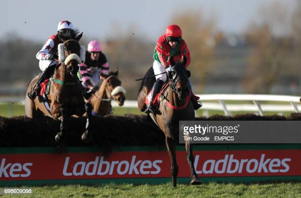 Mondo Cane ridden by Adam Pogson ahead of Oscar O'scar ridden by Steven Fox jumps the last hurdle before winning the Ladbrokes Novices' Handicap...