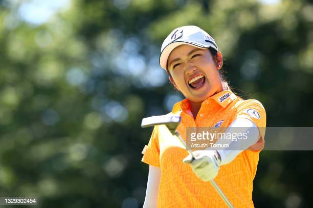 Mone Inami of Japan celebrates after holing out with the birdie on the 18th green during third round of the GMO Internet Ladies Samantha Thavasa...