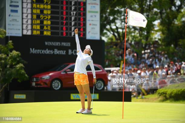 Mone Inami of Japan celebrates the birdie to win the tournament on the 18th green during the final round of the Century 21 Ladies Golf Tournament at...