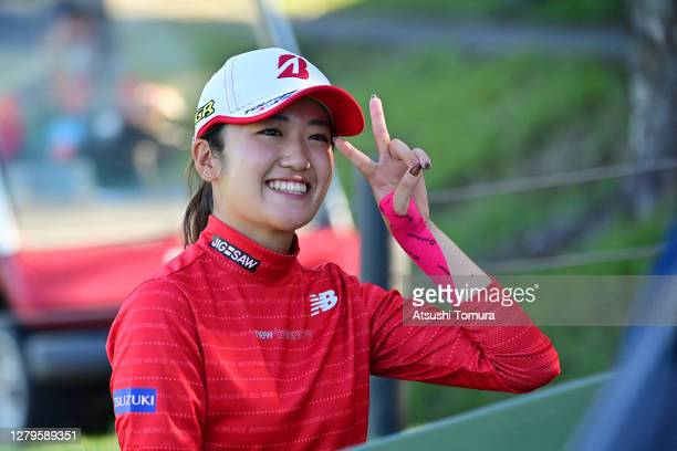 Mone Inami of Japan celebrates winning the tournament after the playoff during the final round of the Stanley Ladies Golf Tournament at the Tomei...