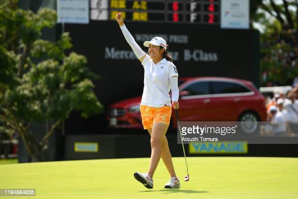 Mone Inami of Japan celebrates winning the tournament on the 18th green during the final round of the Century 21 Ladies Golf Tournament at Ishizaka...