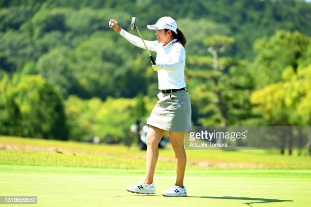 Mone Inami of Japan celebrates winning the tournament on the 18th green during the final round of the Chukyo TV Bridgestone Ladies Open at Chukyo...