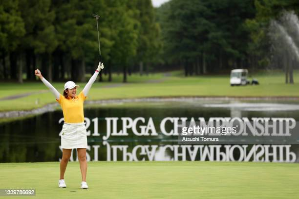 Mone Inami of Japan celebrates winning the tournament on the 18th green during the final round of the JLPGA Championship Konica Minolta Cup at Shizu...
