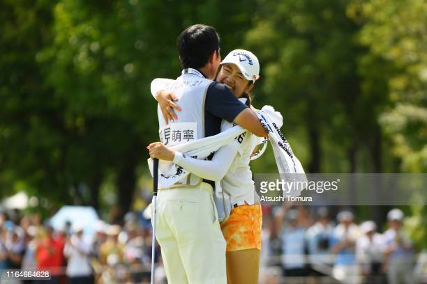 Mone Inami of Japan celebrates winning the tournament with her caddie on the 18th green during the final round of the Century 21 Ladies Golf...