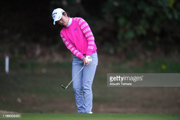 Mone Inami of Japan chips onto the 10th green during the first round of the Daio Paper Elleair Ladies at Elleair Golf Club Matsuyama on November 21...