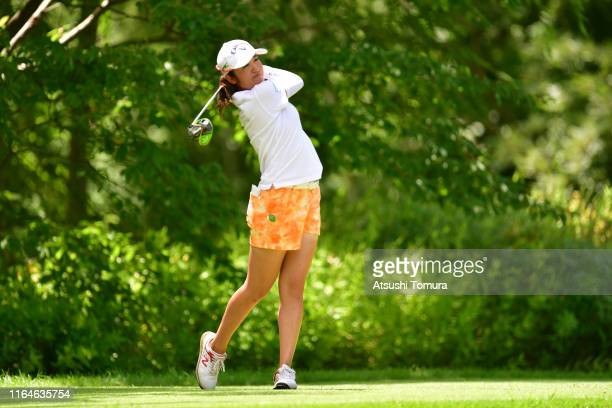 Mone Inami of Japan hits her tee shot on the 8th hole during the final round of the Century 21 Ladies Golf Tournament at Ishizaka Golf Club on July...