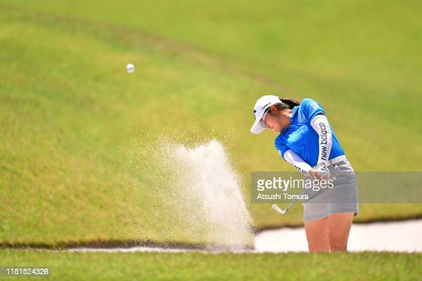 Mone Inami of Japan hits out from a bunker on the 14th hole during the second round of the Chukyo TV Bridgestone Ladies Open at Chukyo Golf Club...