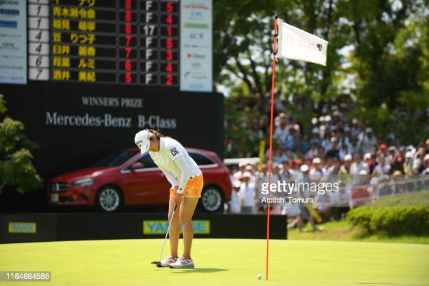 Mone Inami of Japan holes the birdie putt to win the tournament on the 18th green during the final round of the Century 21 Ladies Golf Tournament at...