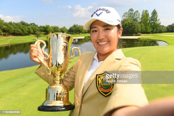 Mone Inami of Japan imitates a selfie after winning the tournament during the final round of the Century 21 Ladies Golf Tournament at Ishizaka Golf...