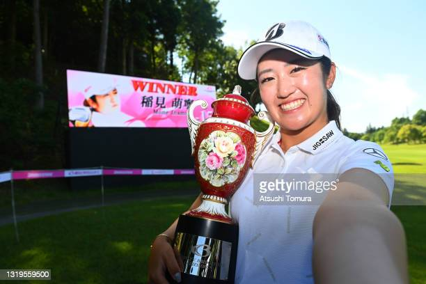 Mone Inami of Japan imitates the selfie after winning the tournament following the final round of the Chukyo TV Bridgestone Ladies Open at Chukyo...