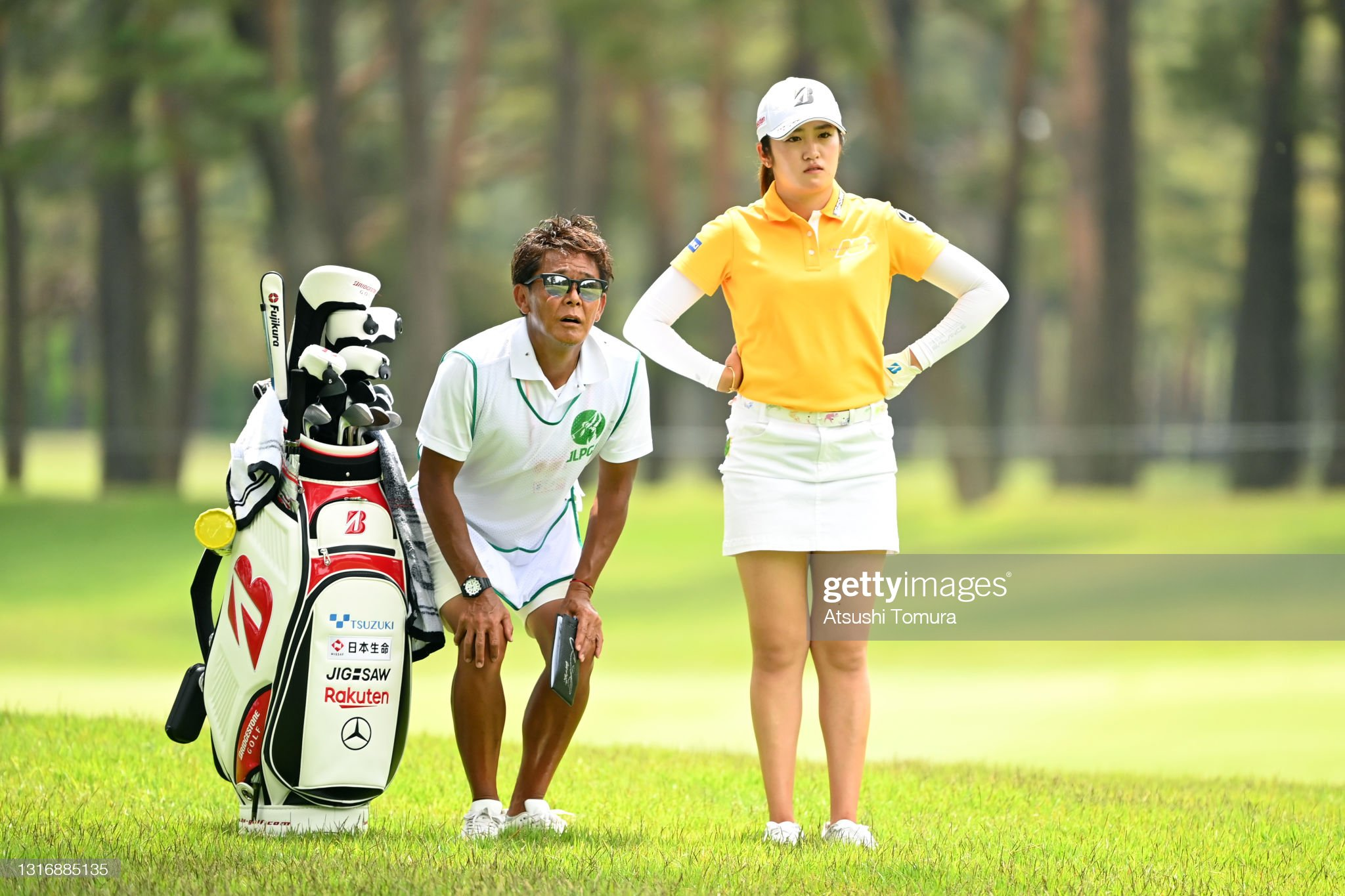 https://media.gettyimages.com/photos/mone-inami-of-japan-is-seen-with-her-caddie-before-her-second-shot-on-picture-id1316885135?s=2048x2048