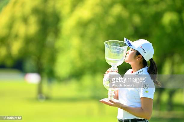 Mone Inami of Japan kisses the trophy after winning the tournament following the final round of the Chukyo TV Bridgestone Ladies Open at Chukyo Golf...