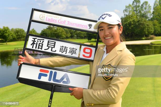 Mone Inami of Japan poses with the score sign after winning the tournament during the final round of the Century 21 Ladies Golf Tournament at...
