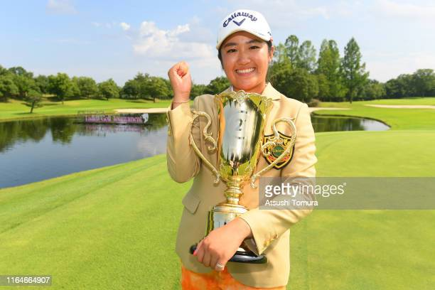 Mone Inami of Japan poses with the trophy after winning the tournament during the final round of the Century 21 Ladies Golf Tournament at Ishizaka...