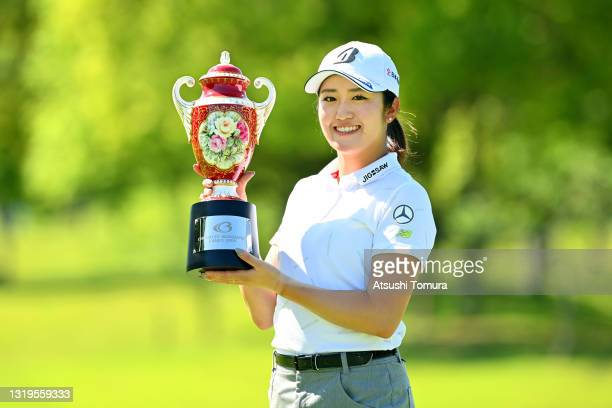 Mone Inami of Japan poses with the trophy after winning the tournament following the final round of the Chukyo TV Bridgestone Ladies Open at Chukyo...