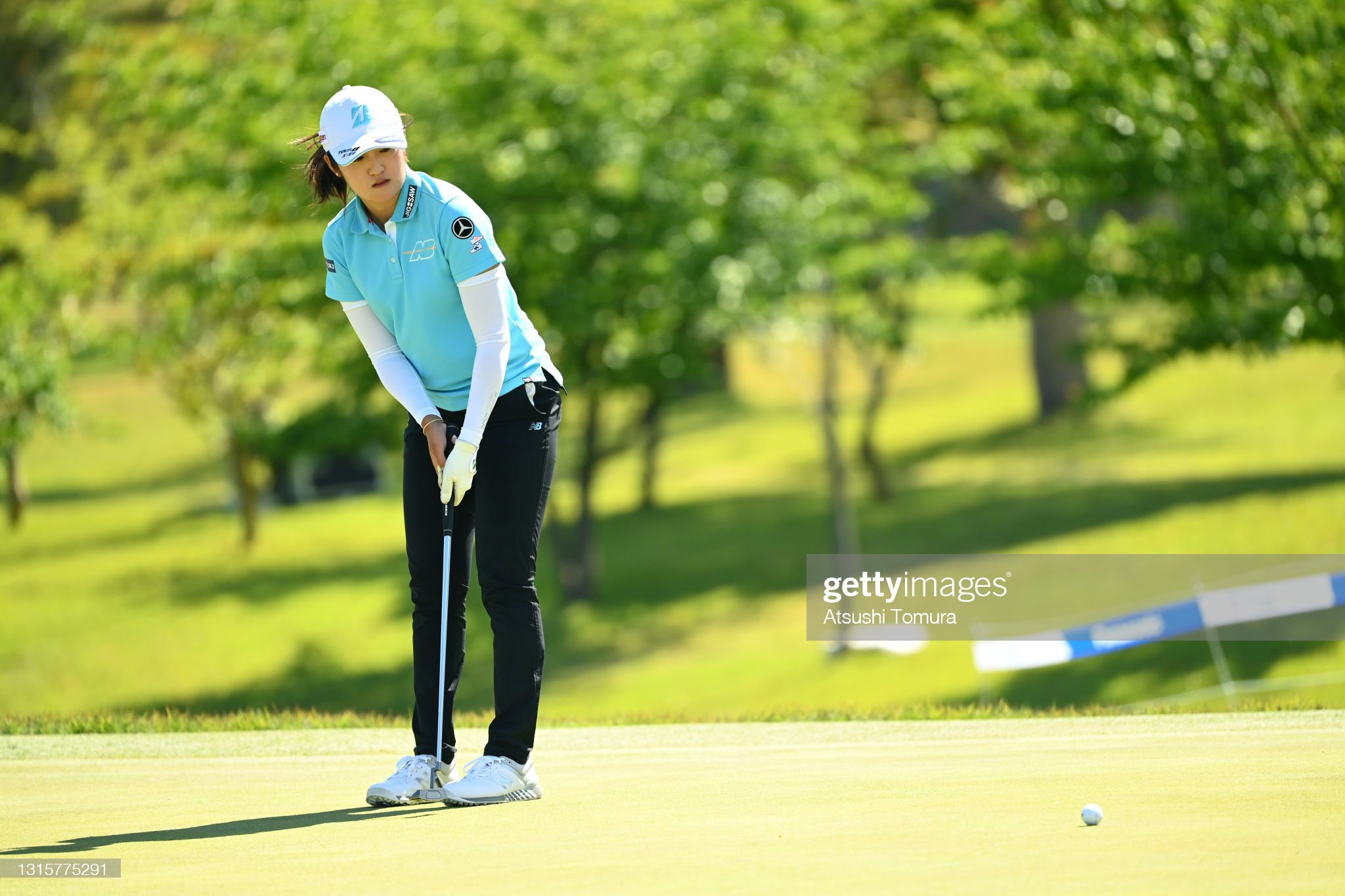 https://media.gettyimages.com/photos/mone-inami-of-japan-reacts-after-a-putt-on-the-18th-green-during-the-picture-id1315775291?s=2048x2048