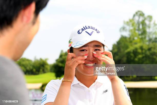 Mone Inami of Japan sheds tears with joy while being interviewed after winning the tournament during the final round of the Century 21 Ladies Golf...