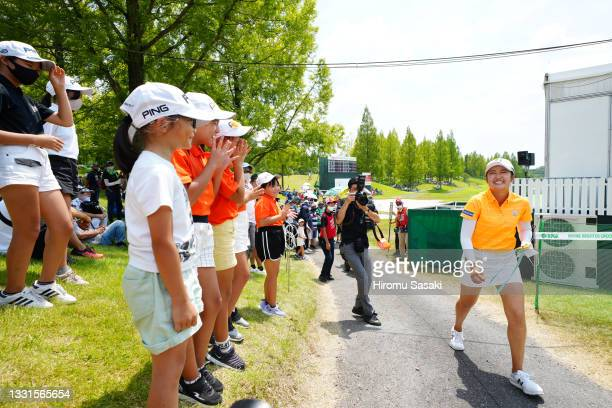Mone Inami of Japan smiles as she is cheered by young fans after holing out following the final round of Rakuten Super Ladies at Tokyu Grand Oak Golf...