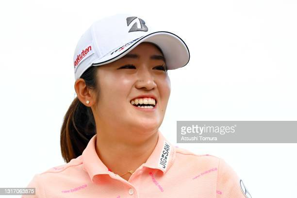Mone Inami of Japan smiles on the 18th green after finishing the final round of the World Ladies Championship Salonpas Cup at the Ibaraki Golf Club...