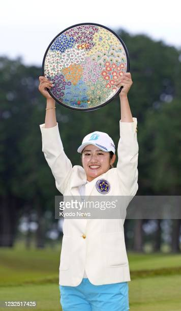 Mone Inami poses for a photo with the trophy after winning the Fujisankei Ladies Classic golf tournament on April 25 at the Kawana Hotel Golf Course...