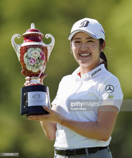 Mone Inami smiles with the trophy after winning the Chukyo TV Bridgestone Ladies Open on the Ishino Course of Chukyo Golf Club in Toyota in Aichi...